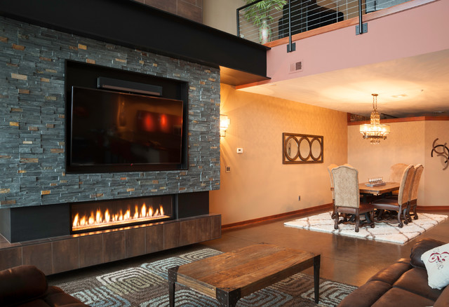 Industrial Downtown Condo Fireplace - Industrial - Living Room ...