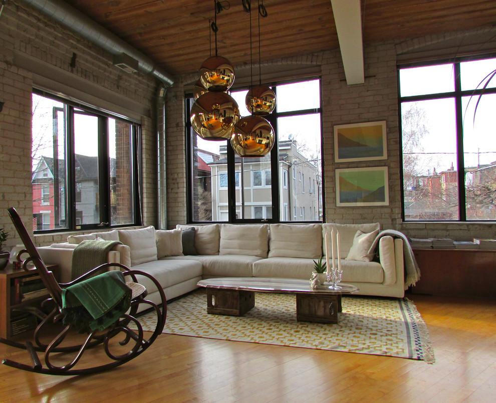 Example of an urban medium tone wood floor living room design in Toronto