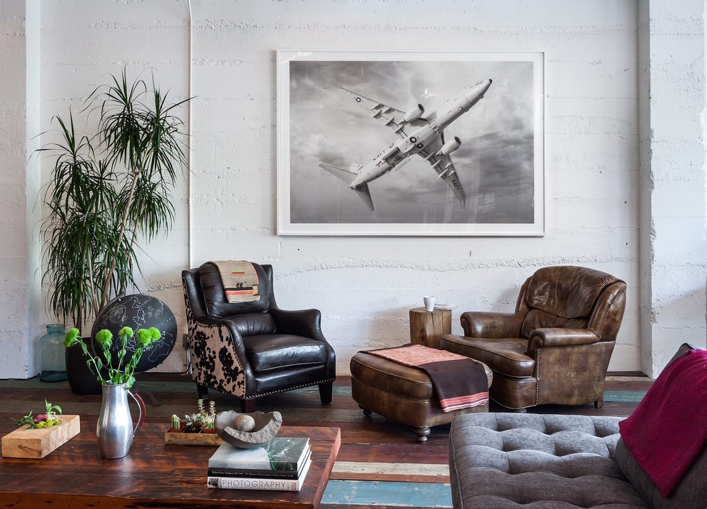 Example of an urban painted wood floor living room design in Portland with white walls