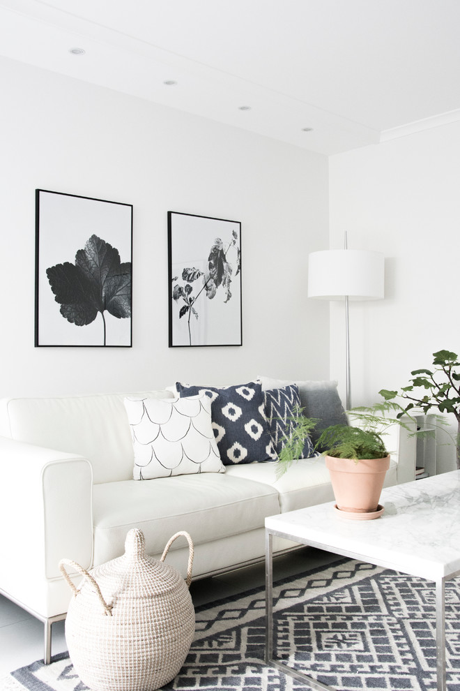 Living room - small scandinavian enclosed living room idea in Stockholm with white walls and no fireplace