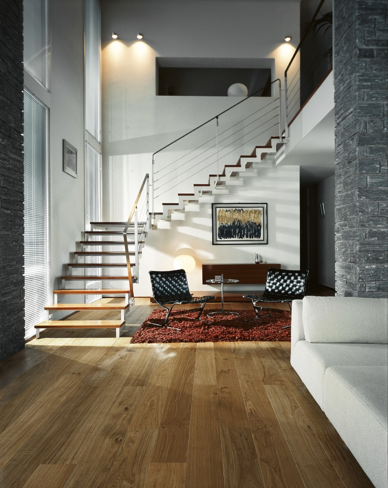 Inspiration for a large contemporary open concept medium tone wood floor living room remodel in Denver with red walls