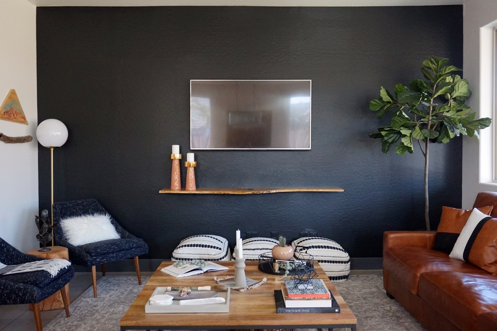Mid-sized 1960s formal and open concept porcelain tile and gray floor living room photo in Phoenix with black walls, no fireplace and a wall-mounted tv