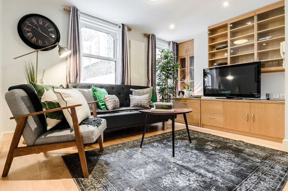 Inspiration for a contemporary light wood floor living room remodel in London with gray walls and a tv stand