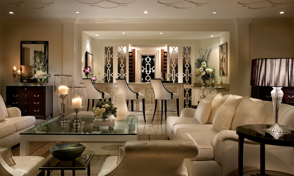 Example of a classic marble floor living room design in Miami with a bar