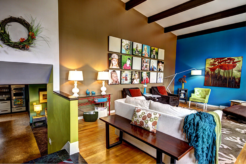 Living room - eclectic loft-style living room idea in Grand Rapids with multicolored walls