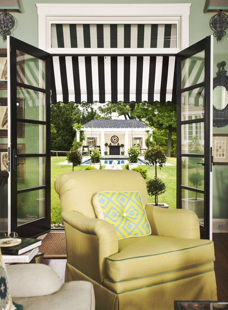 Inspiration for a timeless living room remodel in Baltimore with green walls