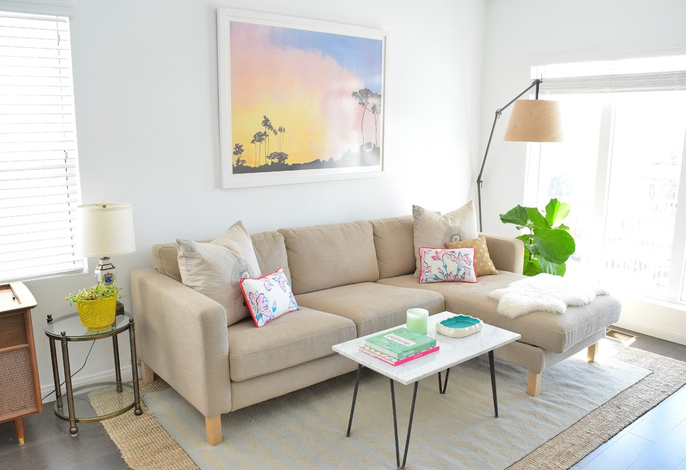 Living room - coastal living room idea in Los Angeles with white walls