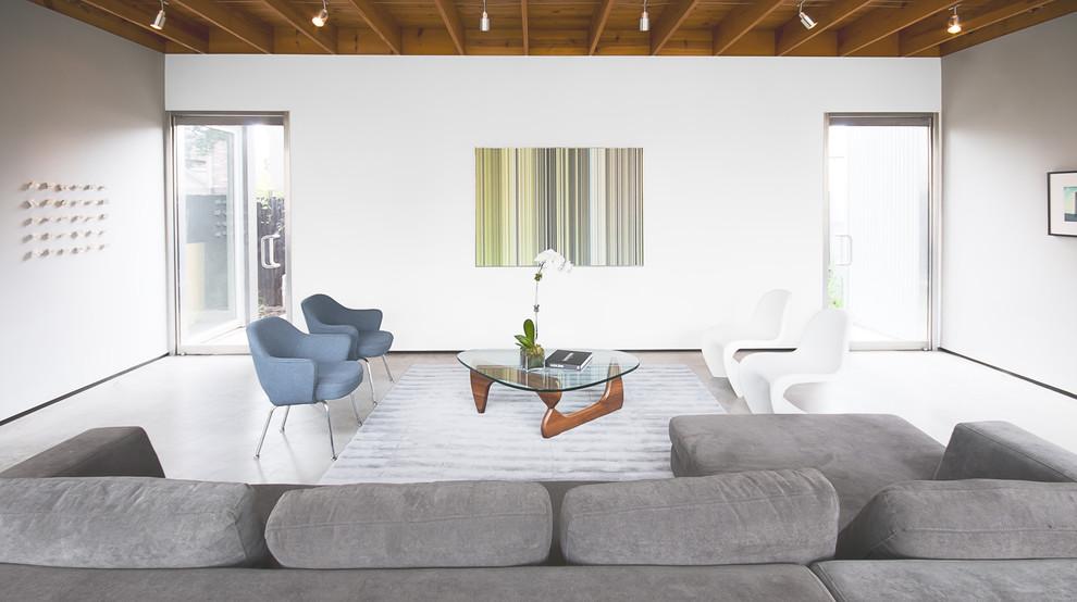 Minimalist concrete floor living room photo in Houston with white walls