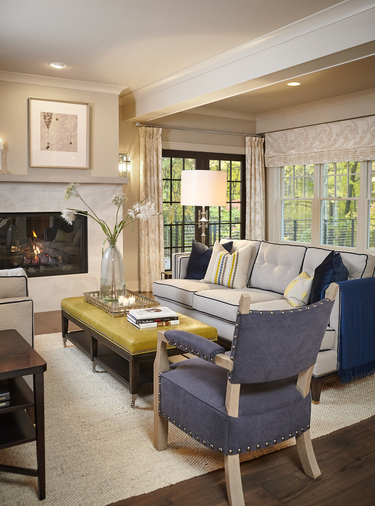 Example of a classic living room design in Grand Rapids with beige walls