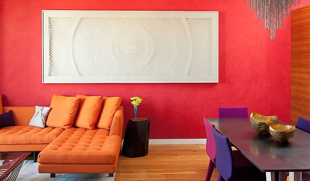 Trendy open concept medium tone wood floor living room photo in San Francisco with red walls and no tv