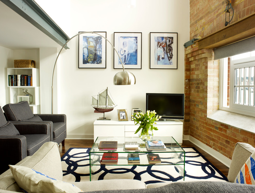 Living room - small industrial living room idea in London with white walls and a tv stand