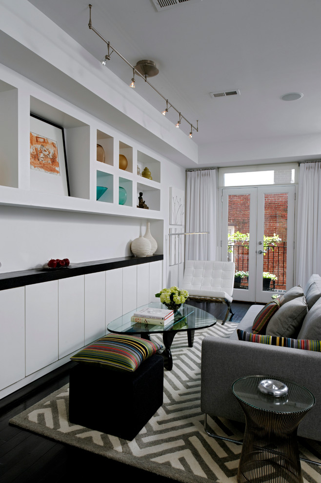 Living room - small contemporary dark wood floor living room idea in DC Metro with white walls