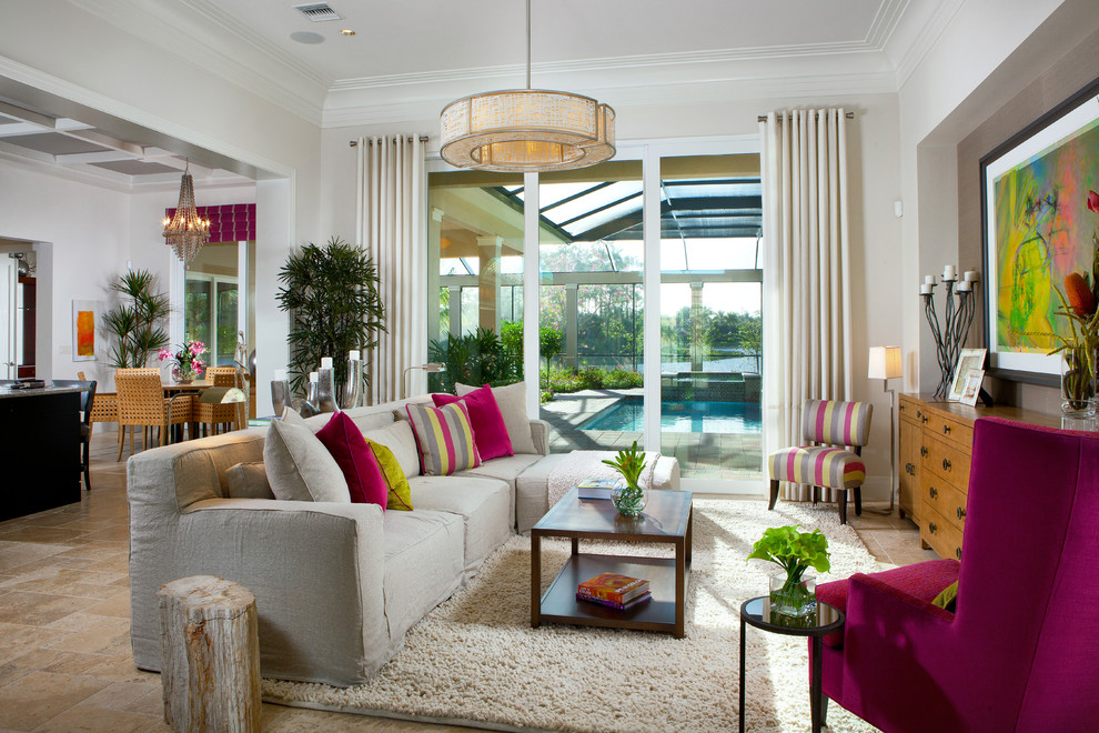 Example of a trendy open concept living room design in Miami with beige walls