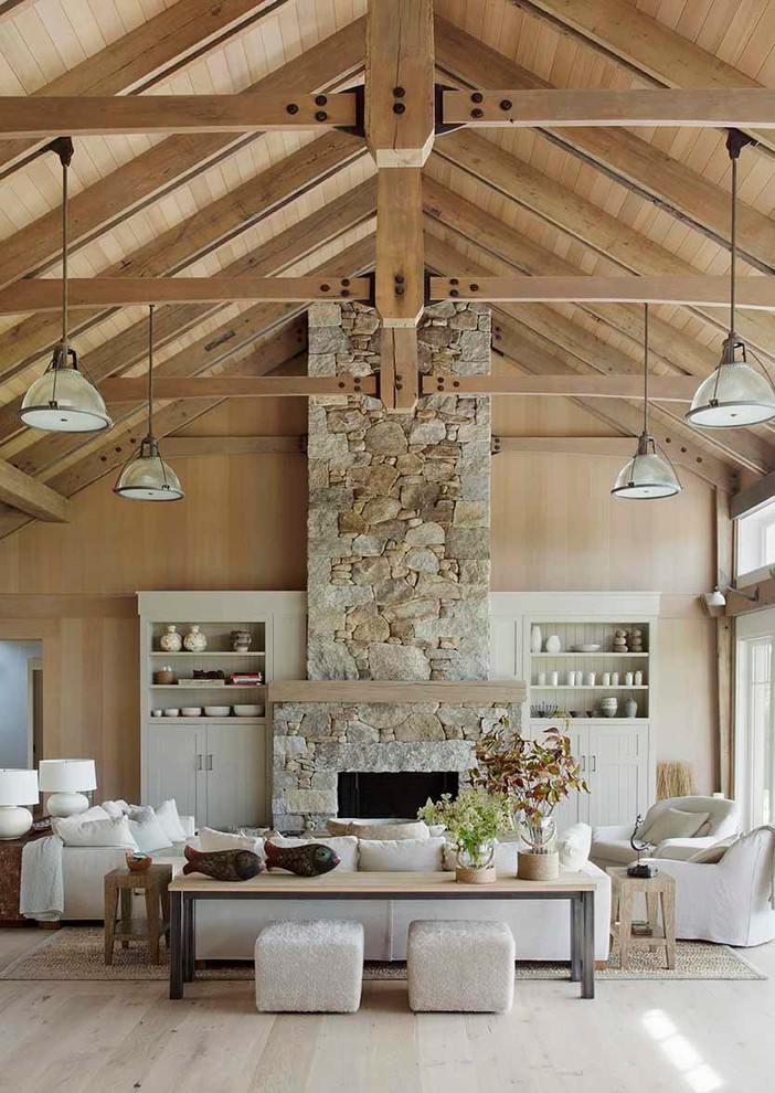 Inspiration for a coastal formal and open concept light wood floor living room remodel in Boston with a standard fireplace and a stone fireplace