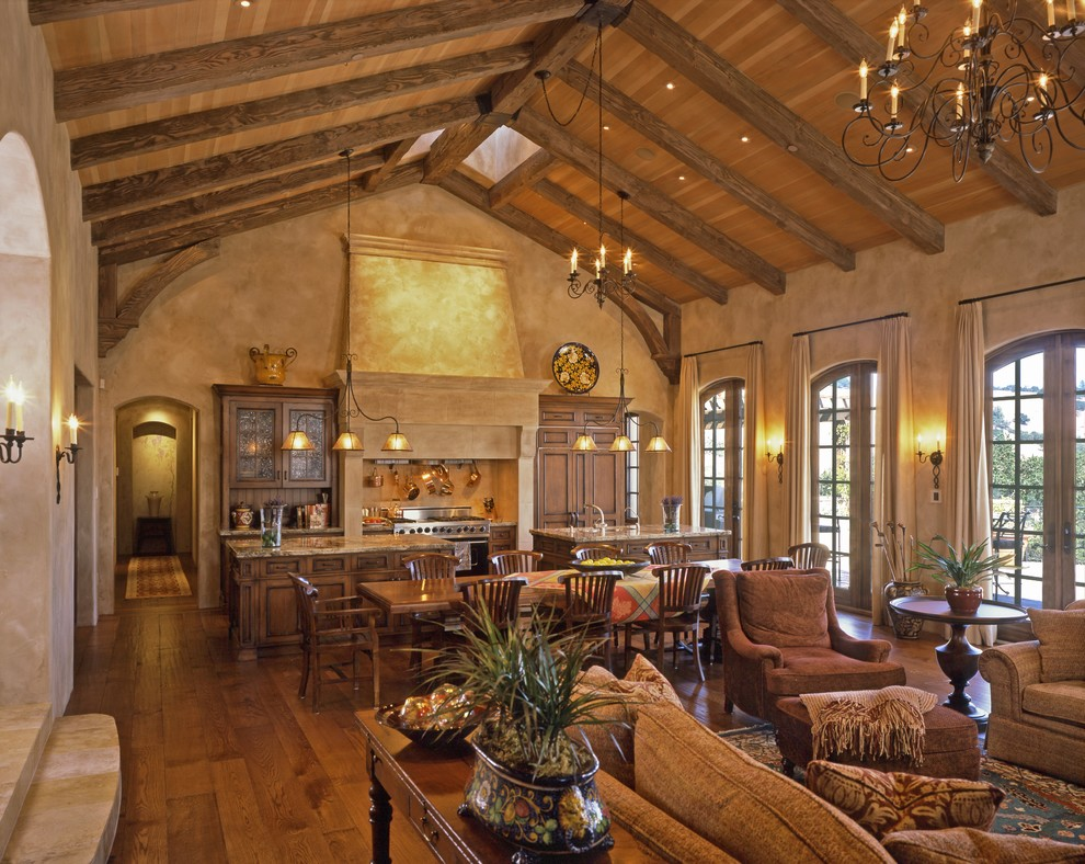 Example of a tuscan open concept medium tone wood floor living room design in San Francisco with brown walls