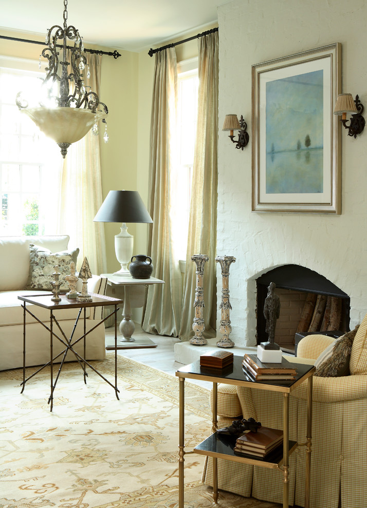 Living room - traditional living room idea in Atlanta with a brick fireplace
