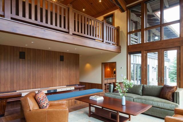Huge rustic medium tone wood floor living room idea in Portland