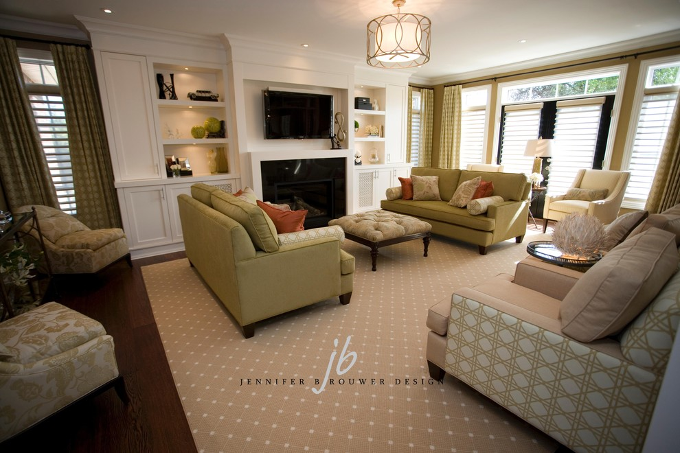 Mid-sized elegant enclosed carpeted living room photo in Toronto with beige walls, a standard fireplace, a wood fireplace surround and a media wall