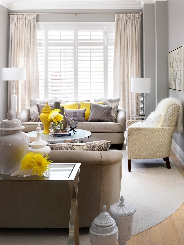 Living room - mid-sized transitional enclosed living room idea in Toronto with gray walls