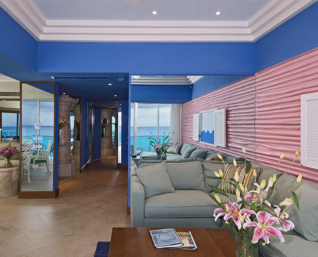 Example of an island style living room design in Other with blue walls