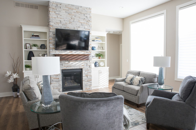 Living room - large transitional open concept vinyl floor and brown floor living room idea in Other with beige walls, a standard fireplace, a stone fireplace and a wall-mounted tv
