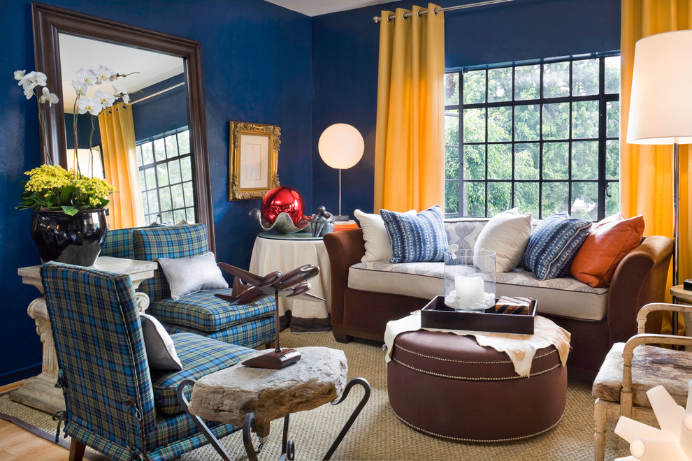 Example of an eclectic living room design in Los Angeles with blue walls