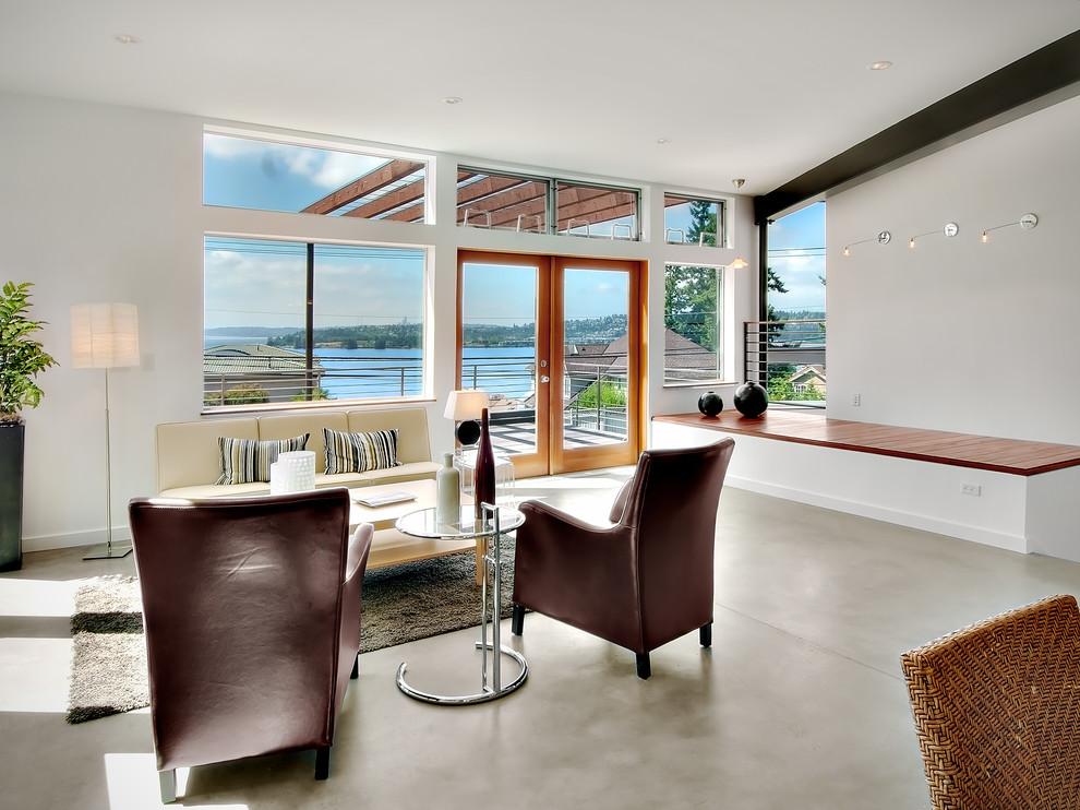 Example of a trendy concrete floor living room design in Seattle