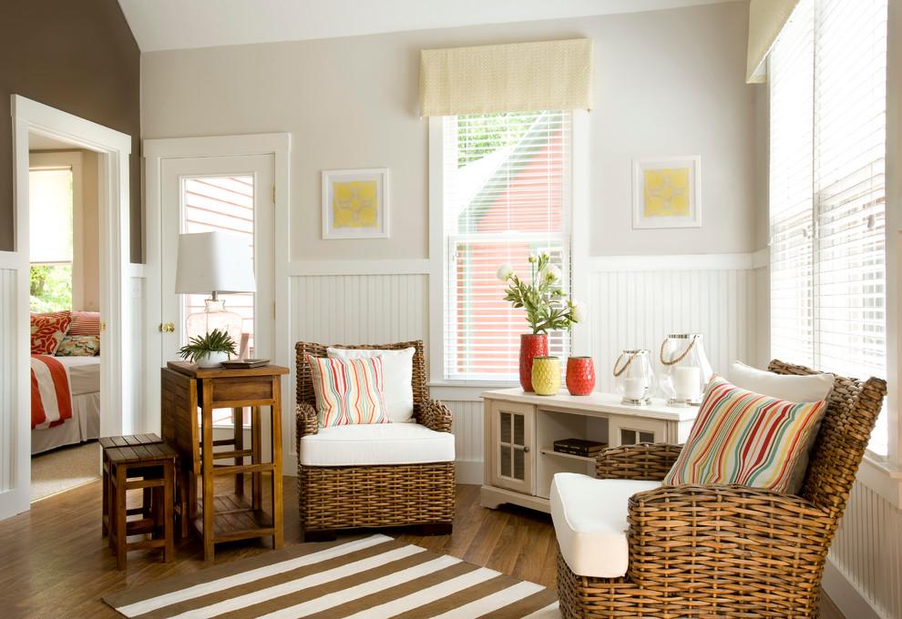 Small beach style medium tone wood floor living room photo in Boston with beige walls