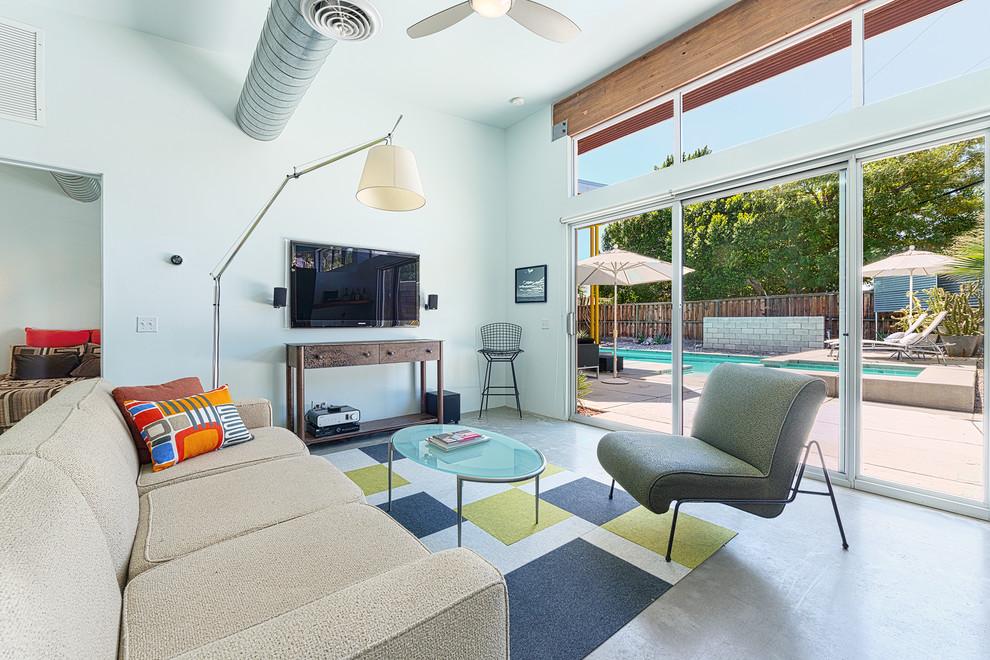 Living room - modern concrete floor living room idea in Other