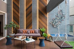 See How Designers Decorate Double-Height Living Rooms