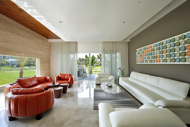 Mid-sized contemporary living room in Ahmedabad with beige floor.