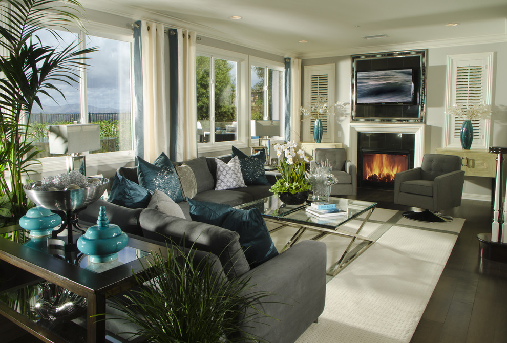 Example of a classic living room design in Denver with gray walls and a standard fireplace