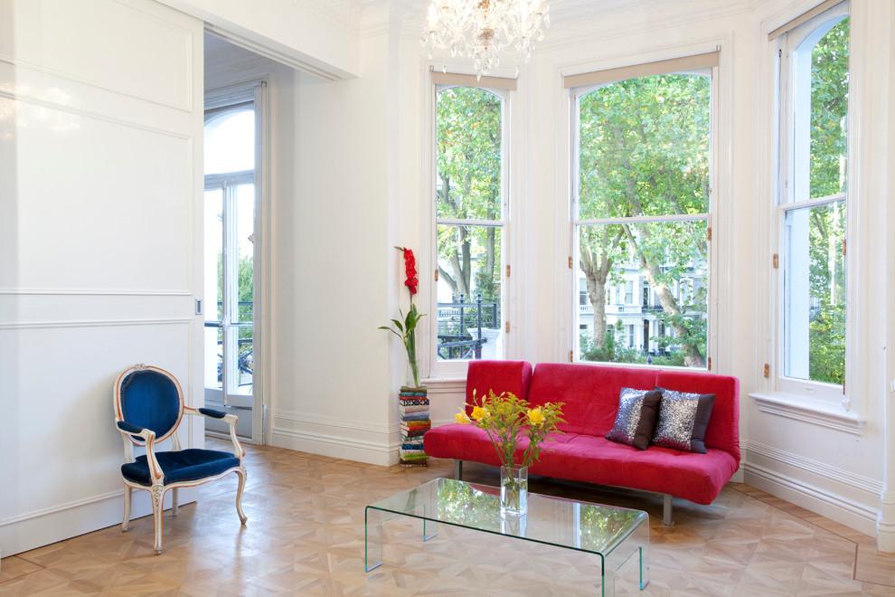 Living room - scandinavian light wood floor living room idea in London with white walls