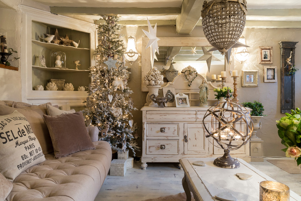 Cottage chic living room photo in London