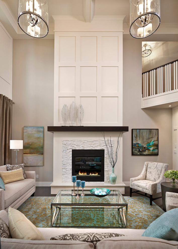 Example of a transitional living room design in Edmonton with beige walls, a standard fireplace and a stone fireplace
