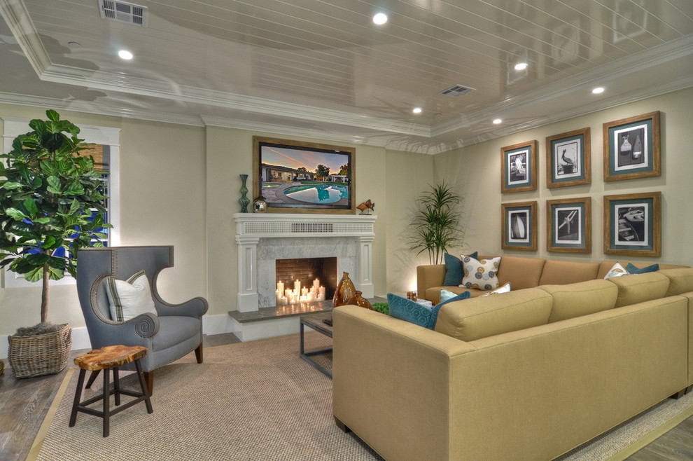 Living room - transitional living room idea in Orange County with beige walls and a standard fireplace