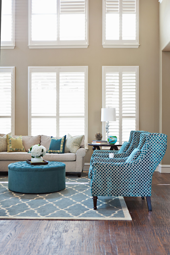 Example of a transitional living room design in Dallas with beige walls