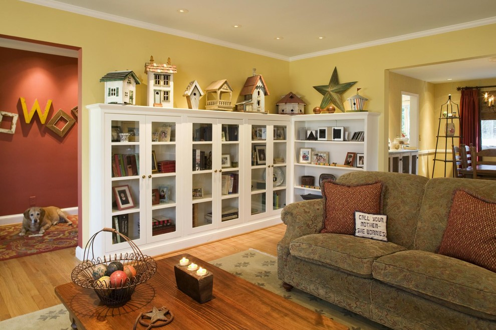 Living room - mid-sized eclectic enclosed light wood floor and brown floor living room idea in DC Metro with yellow walls and no tv