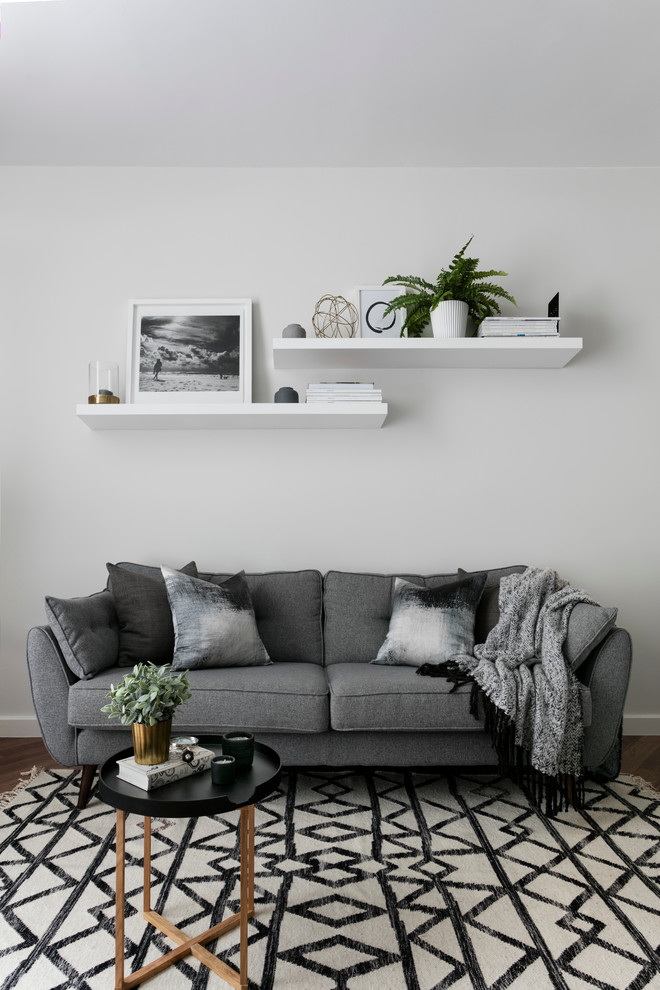 Living room - scandinavian living room idea in London with white walls