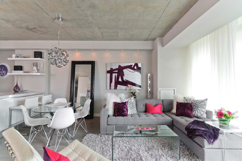 Inspiration for a contemporary open concept living room remodel in Toronto with no fireplace