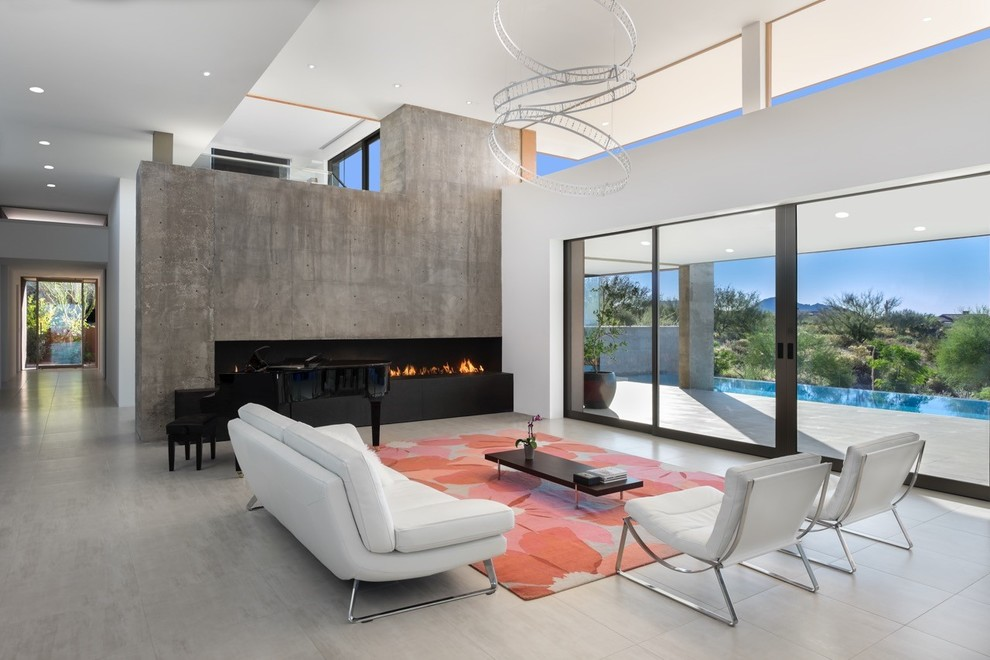 Living room - large southwestern open concept and formal concrete floor and gray floor living room idea in Phoenix with white walls, a ribbon fireplace, a concrete fireplace and no tv