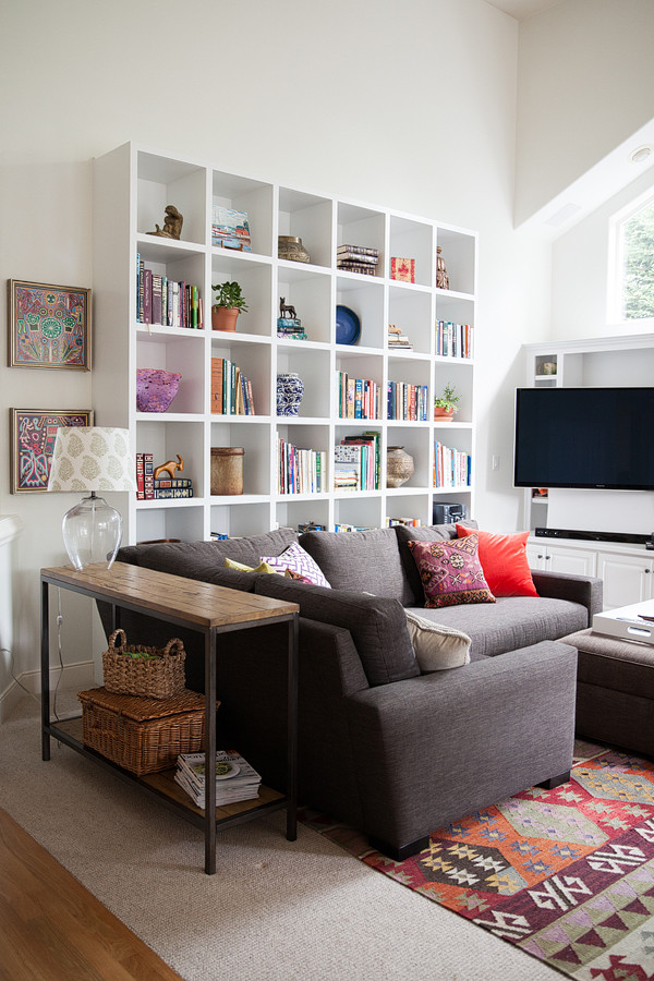 Example of a mid-sized eclectic open concept carpeted living room design in Other with white walls, a standard fireplace, a stone fireplace and a wall-mounted tv