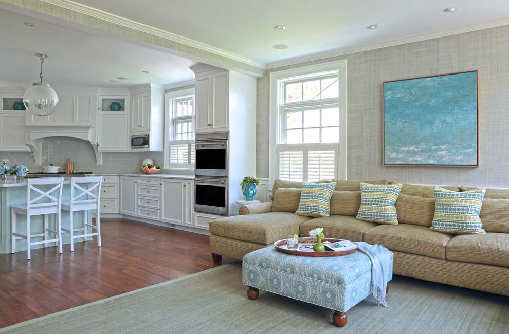 Elegant open concept medium tone wood floor living room photo in New York with gray walls