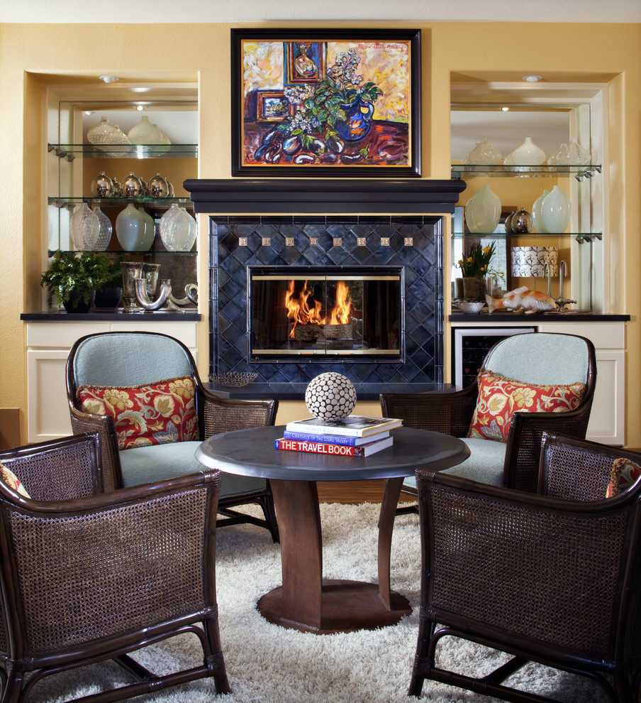 Elegant living room photo in San Francisco with yellow walls and a standard fireplace