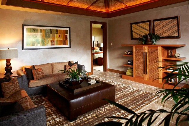 Inspiration for a tropical living room remodel in Hawaii with gray walls