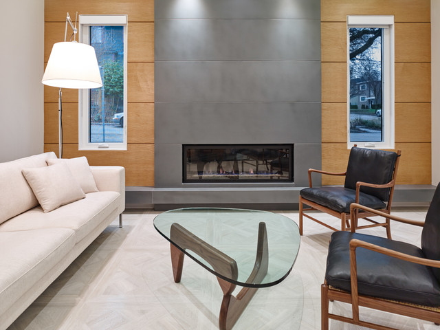 Example of a trendy formal and open concept porcelain floor living room design in Vancouver with multicolored walls, a standard fireplace, a concrete fireplace and no tv