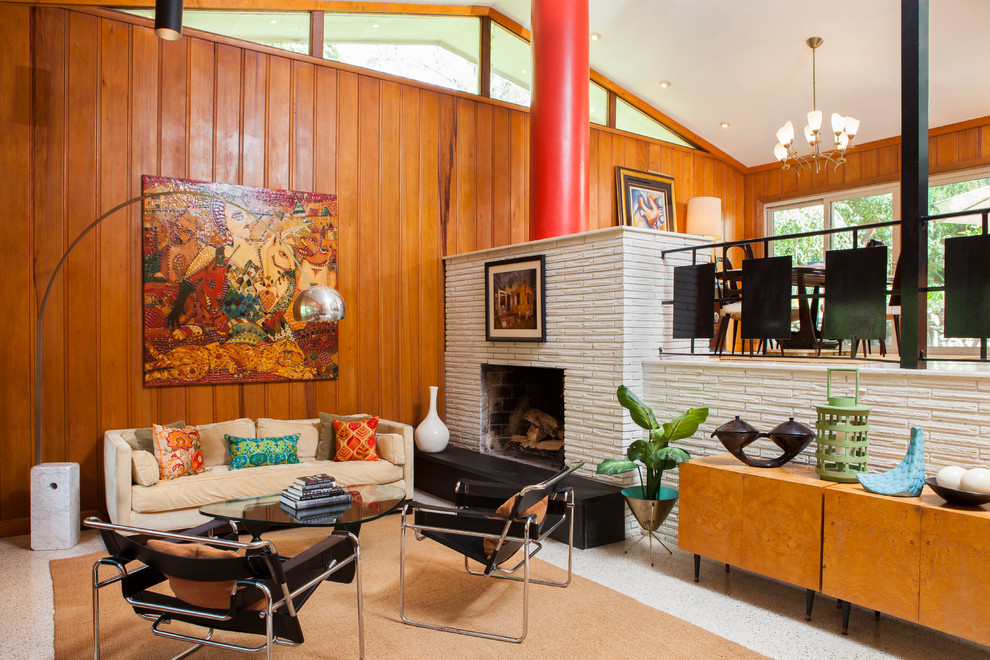 Inspiration for a mid-century modern living room remodel in Atlanta with a standard fireplace
