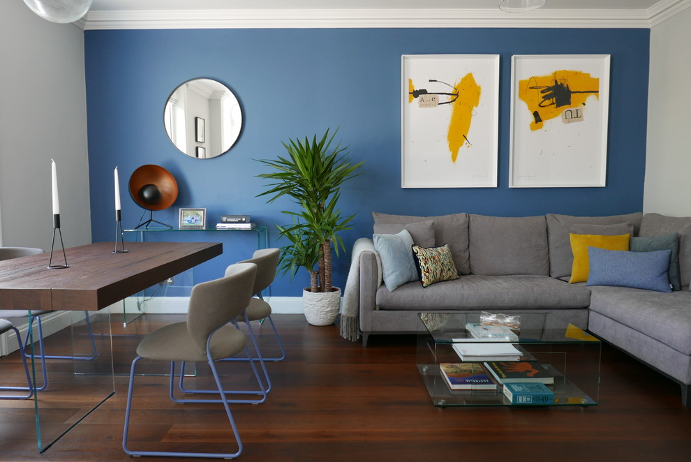 Living room - small contemporary open concept dark wood floor and brown floor living room idea in London with blue walls and no fireplace