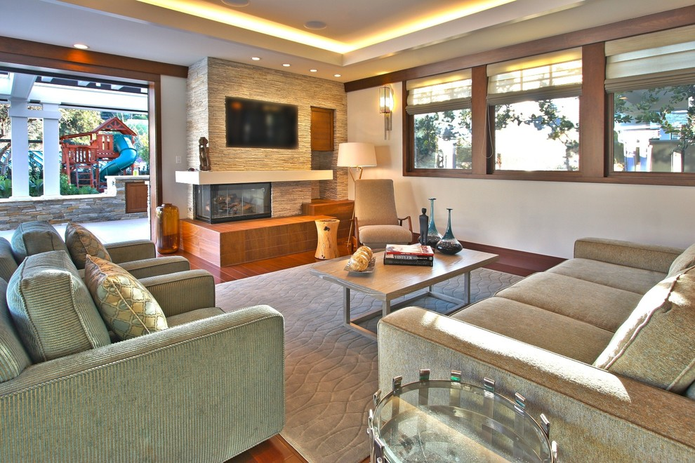 Trendy living room photo in Los Angeles with a corner fireplace and a stone fireplace