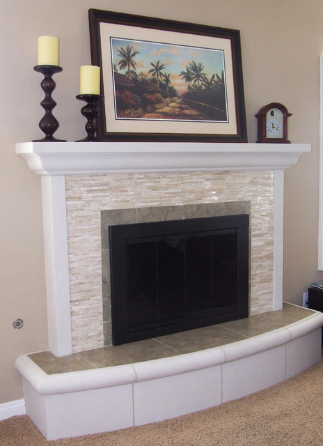 Remodel of brick fireplace. Split-face travertine cladding with limestone trim and hearth stone.